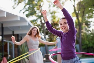 getty_rf_photo_of_girl_doing_hula_hoop